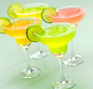 flavored frozen drinks in margarita glasses